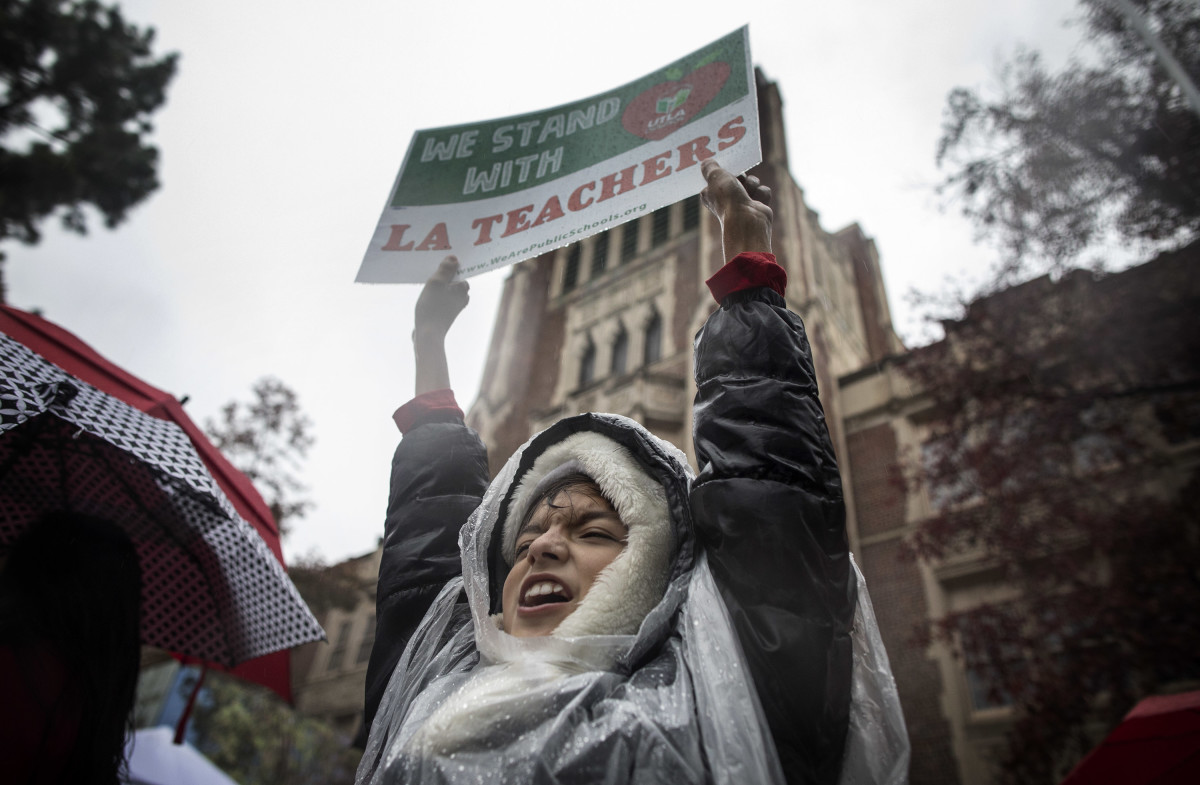Student Alessandro Niculescu joins teachers, students, friends, and family to protest and picket in the pouring rain outside John Marshall High School during a United Teachers Los Angeles strike on Monday, January 14th, 2019, in Los Angeles, California. Alessandro's father is a teacher at the school. Teachers from the country's second-biggest school district went on strike after weeks of negotiations for more pay and smaller class sizes went nowhere.