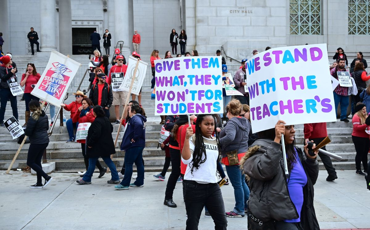 Striking teachers and supporters rally outside City Hall as negotiations resume on Friday, January 18th, 2019, in Los Angeles, California.