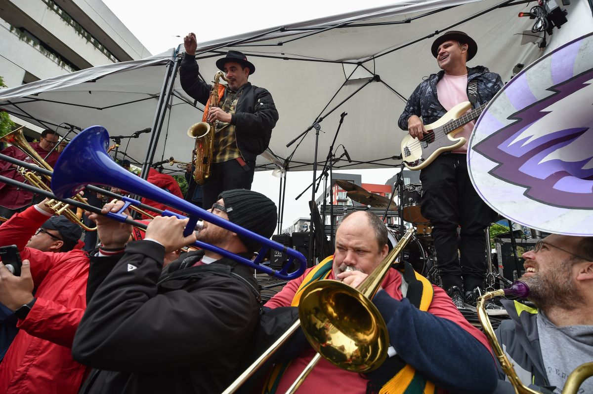 The band Ozomatli (on stage) and public school music teachers (below) perform at a rally by striking teachers in downtown Los Angeles, California, on the second day of the teachers strike on Tuesday, January 15th, 2019.