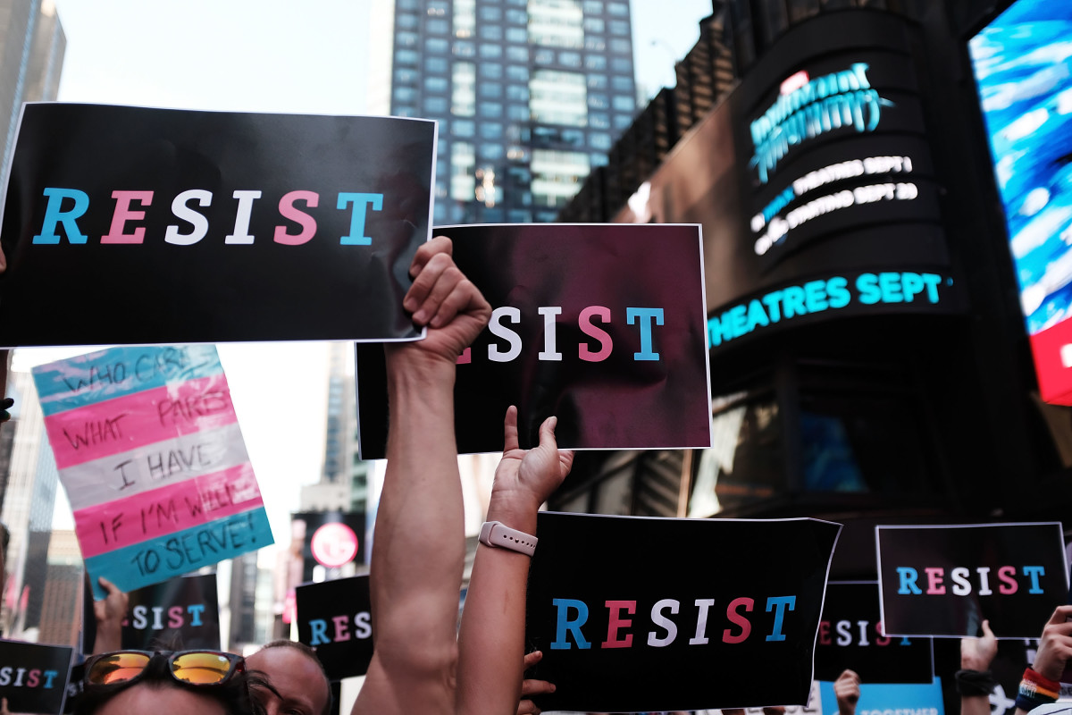 Protesters gather in Times Square near a military recruitment center to show their anger at President Donald Trump's decision to reinstate a ban on transgender individuals from serving in the military on July 26th, 2017, in New York City.