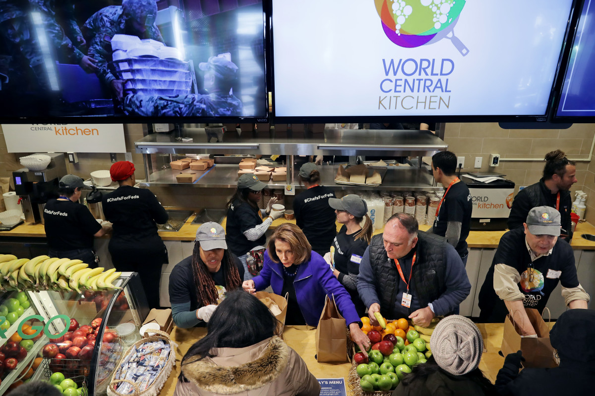United States Speaker of the House Nancy Pelosi (center) and celebrity chef Jose Andres (second from the right) help distribute food to furloughed federal workers at the World Central Kitchen on January 22nd, 2019, in Washington, D.C. Founded by Andres, World Central Kitchen is a not-for-profit non-governmental organization devoted to providing meals in the wake of natural disasters—and, in this case, the government shutdown. The kitchen has been providing meals to workers affected by the partial federal government shutdown since January 16th and started giving away groceries and providing other services this week.