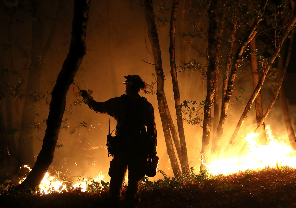 Cal Fire firefighter Brandon Tolp monitors a firing operation while battling the Tubbs Fire on October 12th, 2017, near Calistoga, California.