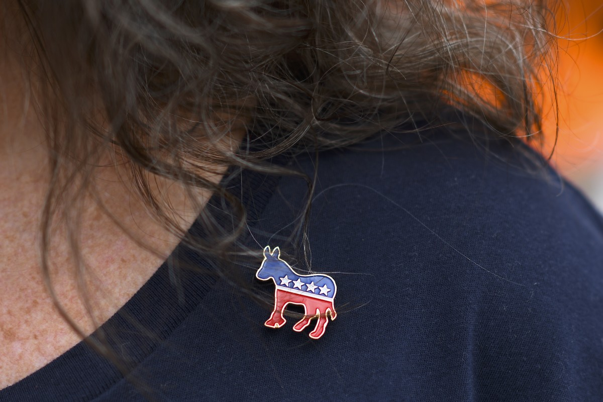 PHILADELPHIA, PA - SEPTEMBER 21: Donna Elms wears a Democrat donkey pin while lining up outside in advance of a campaign rally with former President Barack Obama, Pennsylvania Governor Tom Wolf, and Senator Bob Casey (D- PA) on September 21, 2018 in Philadelphia, Pennsylvania. Midterm election Day is November 6th.