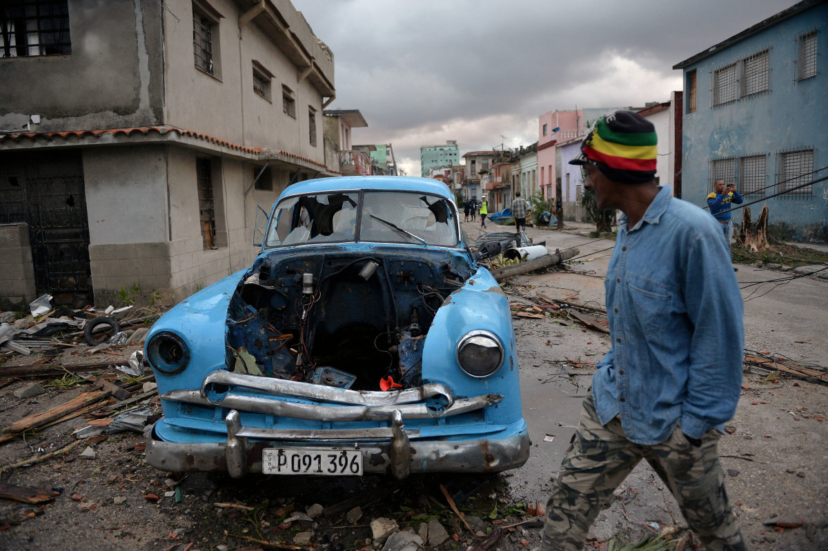 A car damaged by debris from a building is seen in Havana, Cuba, after a rare and powerful tornado struck the city on Monday, January 28th, 2019, killing three people and leaving 172 injured, Cuban President Miguel Diaz-Canel said early Monday.