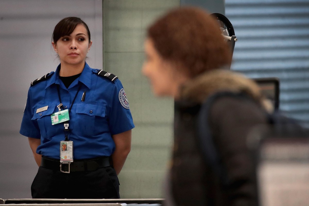 A Transportation Security Administration worker screens passengers at O'Hare International Airport on January 7th, 2019, in Chicago, Illinois.