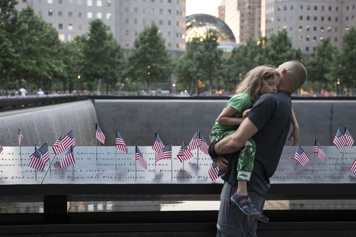 Small American flags are placed in all 2,983 names on the 9/11 Memorial on July 4th, 2017, in New York City.