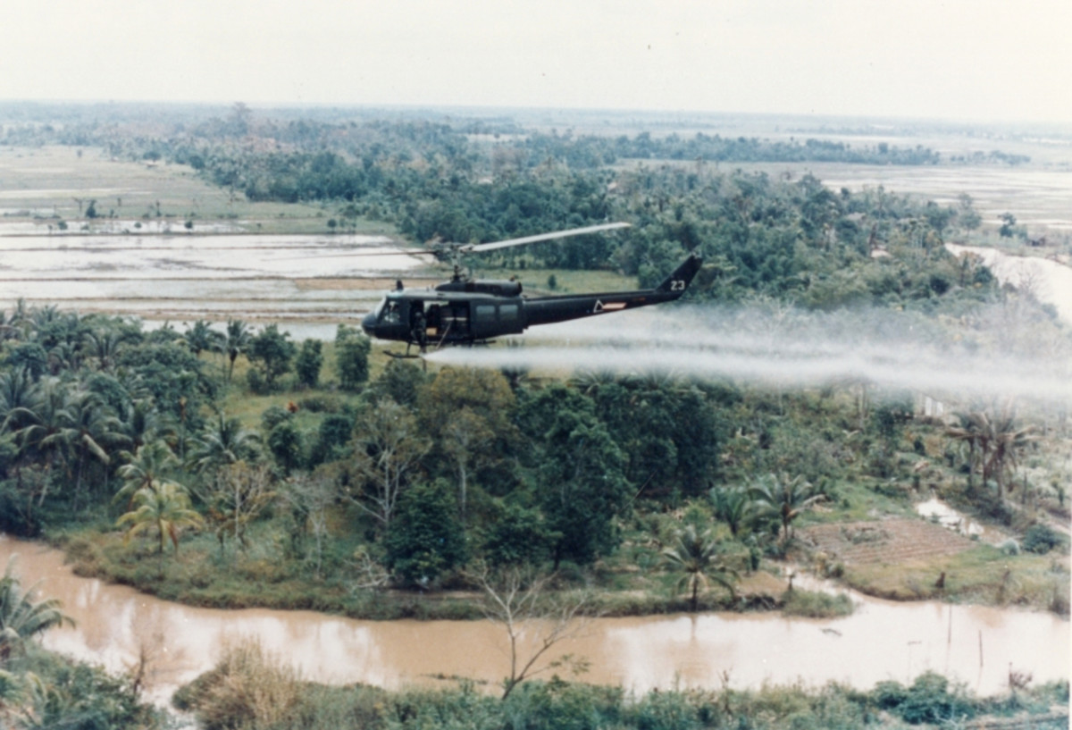 A U.S. Huey helicopter sprays Agent Orange over Vietnam.