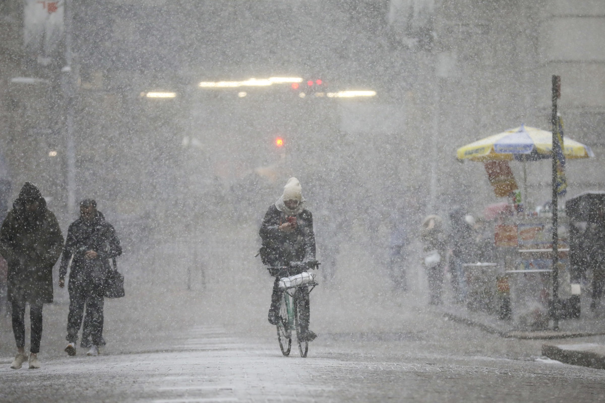 A cyclist rides through the falling snow in the Financial District, January 30th, 2019, in New York City.