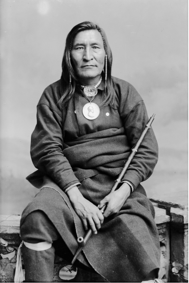 Chief Little Shell in Partial Native Dress with Abraham Lincoln Peace Medal and Ornaments and Holding Pipe, circa 1880.