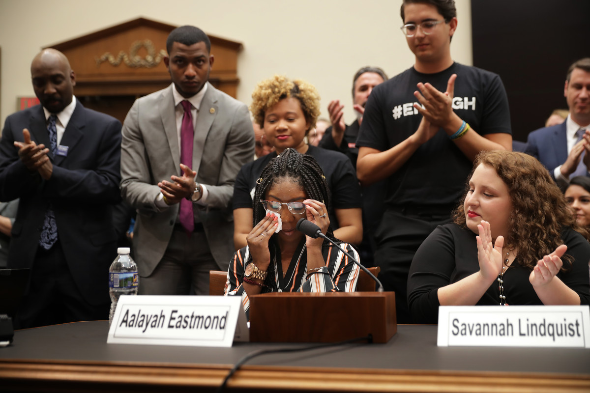 Aalayah Eastmond, a survivor of the mass shooting at Marjory Stoneman Douglas High School in Parkland, Florida, wipes away tears as she receives a standing ovation while testifying to the House Judiciary Committee on February 6th, 2019.