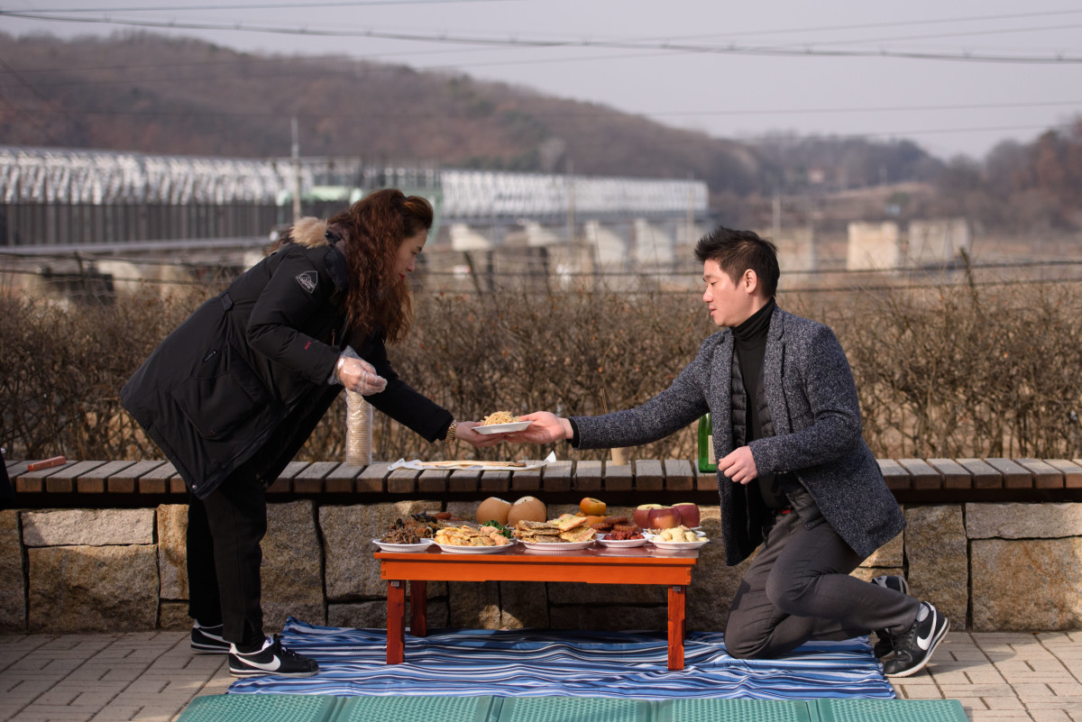 "North Korean refugees set a table as they prepare to pay respects to relatives and ancestors from North Korea on the occasion of the Lunar New Year, at the Imjingak ""peace park"" near the Demilitarized Zone separating North and South Korea, in Paju, on February 5th, 2019."