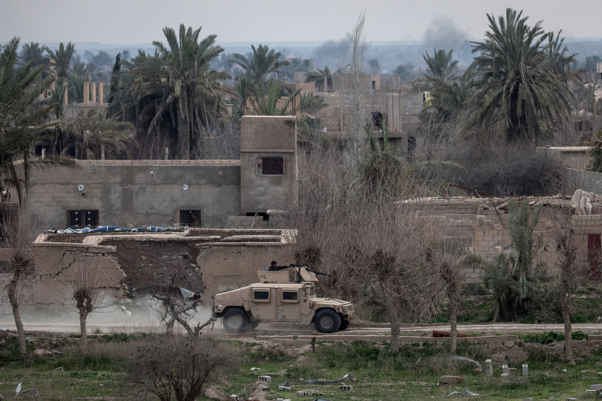 A Syrian Democratic Forces armored vehicle drives through streets near the frontline on February 10th, 2019, in Bagouz, Syria, as part of the SDF's campaign to oust ISIS fighters from the last village in eastern Syria held by the extremist group.