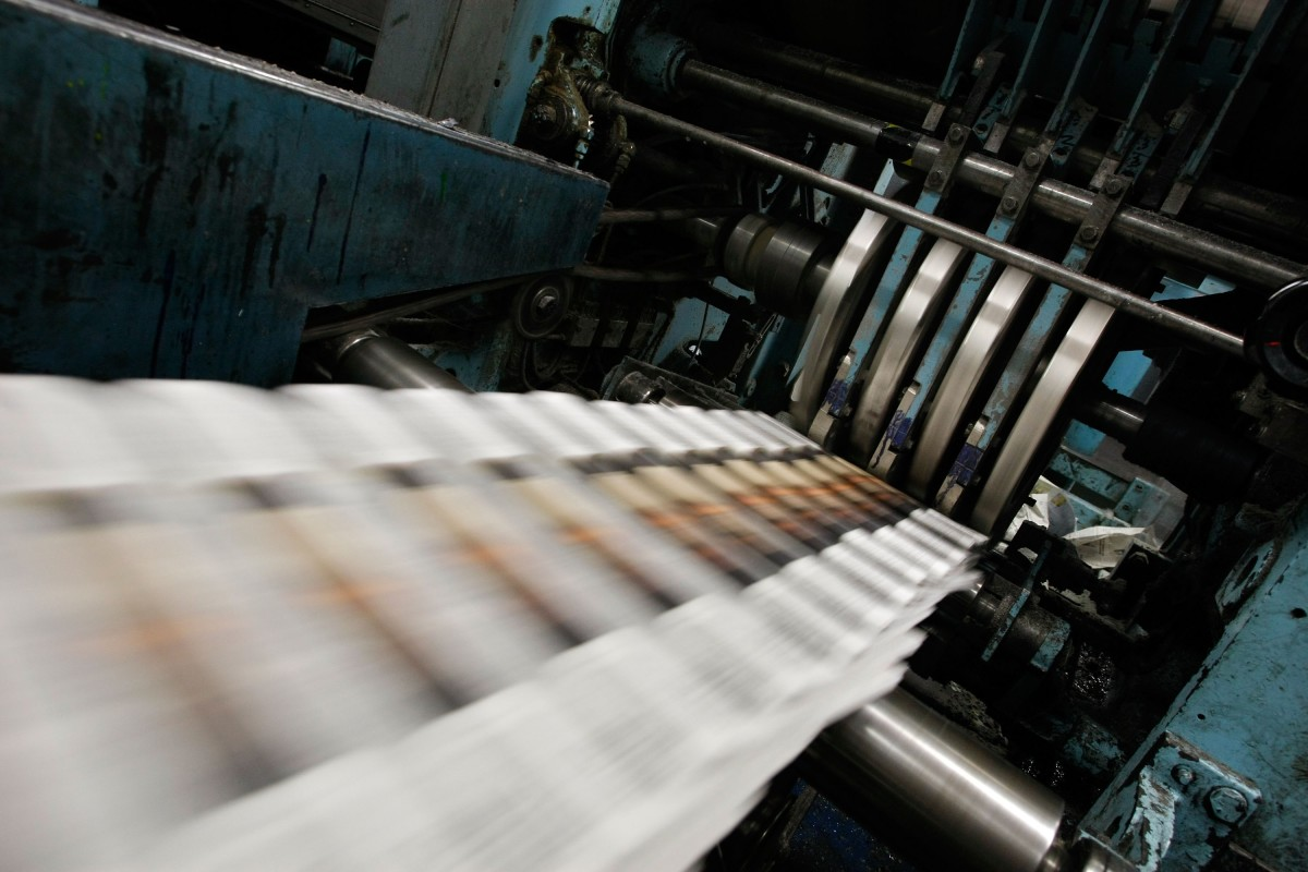 A newspaper printing press.