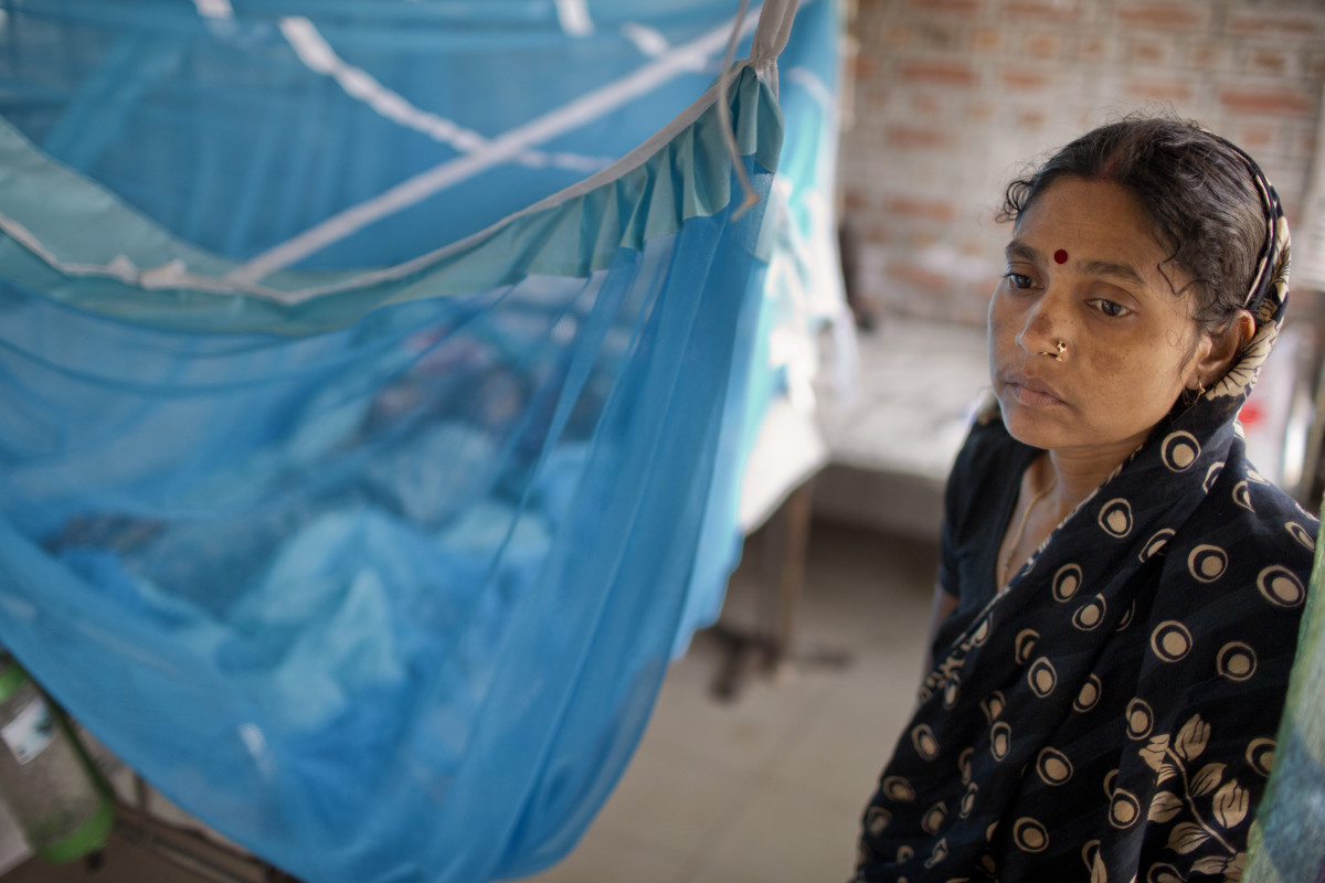 A young mother stands watch over her son who was admitted at Faridpur Medical College Hospital with symptoms of encephalitis. Diagnostic tests later determined that Nipah virus was not the cause of his illness.