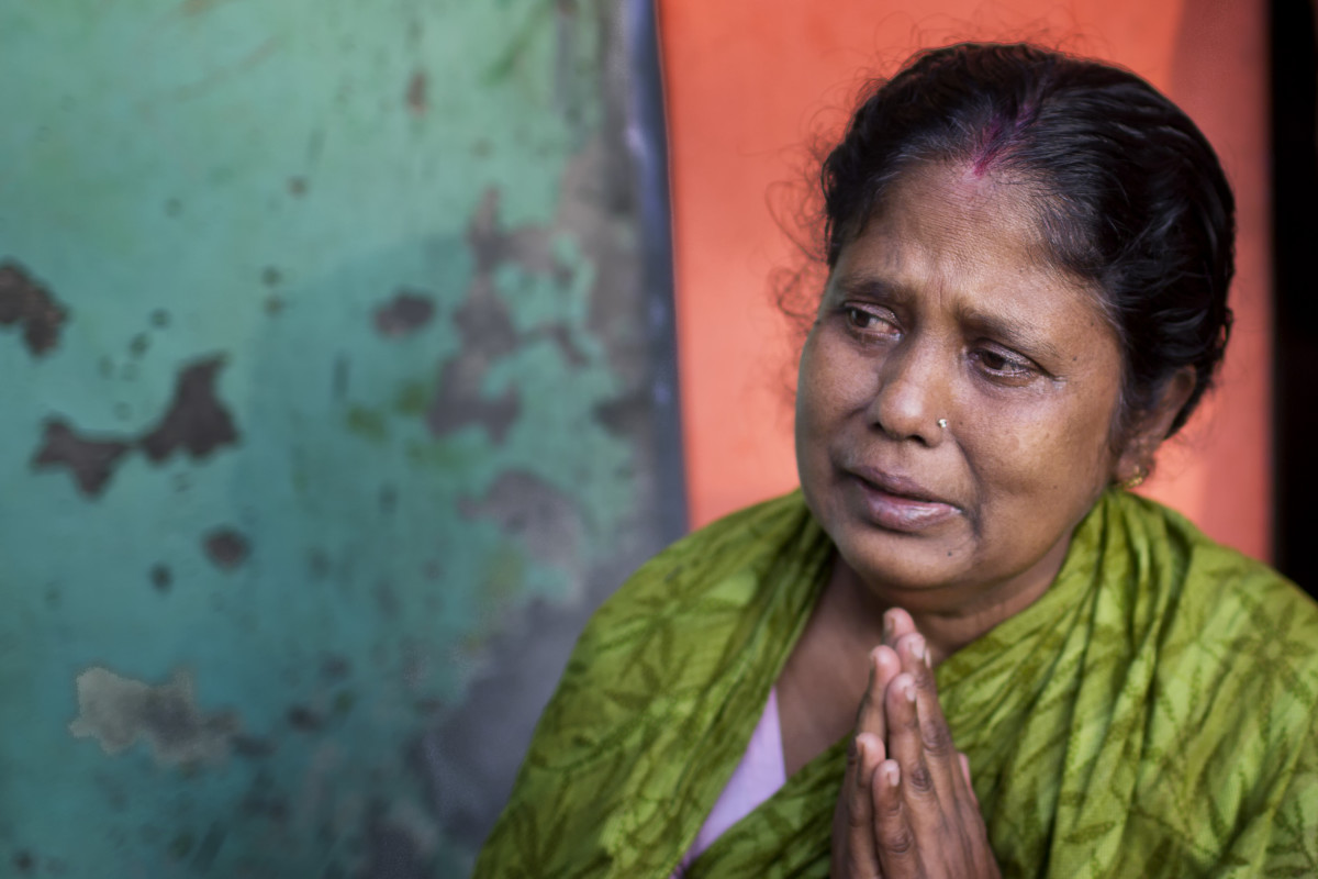 Since 2001, when Nipah virus was first recognized in Bangladesh, the pathogen has taken a heavy toll. This mother in Faridpur prays for her son who fell ill after drinking date palm sap during a gathering to celebrate his graduation from high school. He has since died.