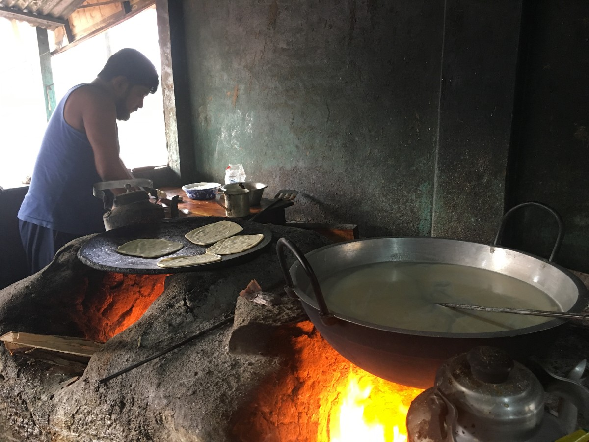 It's not hard to find a meal in Rangpur City. Nearly everywhere you look, vendors are cooking traditional meals over wood fires and propane stoves.
