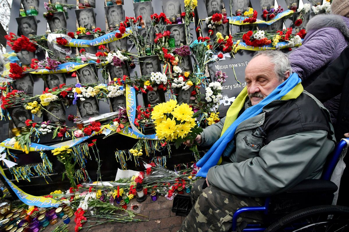 An activist pays tribute at a memorial for the more than 100 Maidan activists who were killed during the 2014 Ukranian revolution, at a memorial event near Independence Square in Kiev, Ukraine, on February 20th, 2019. Ukraine is marking the fifth anniversary of the bloody end to the revolution that ousted Russian-backed president Viktor Yanukovych between February 18th and February 20th, 2014.