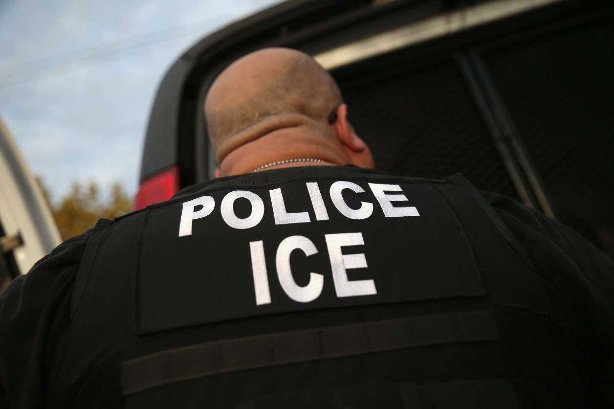 ICE agents detain an immigrant on October 14th, 2015, in Los Angeles, California.