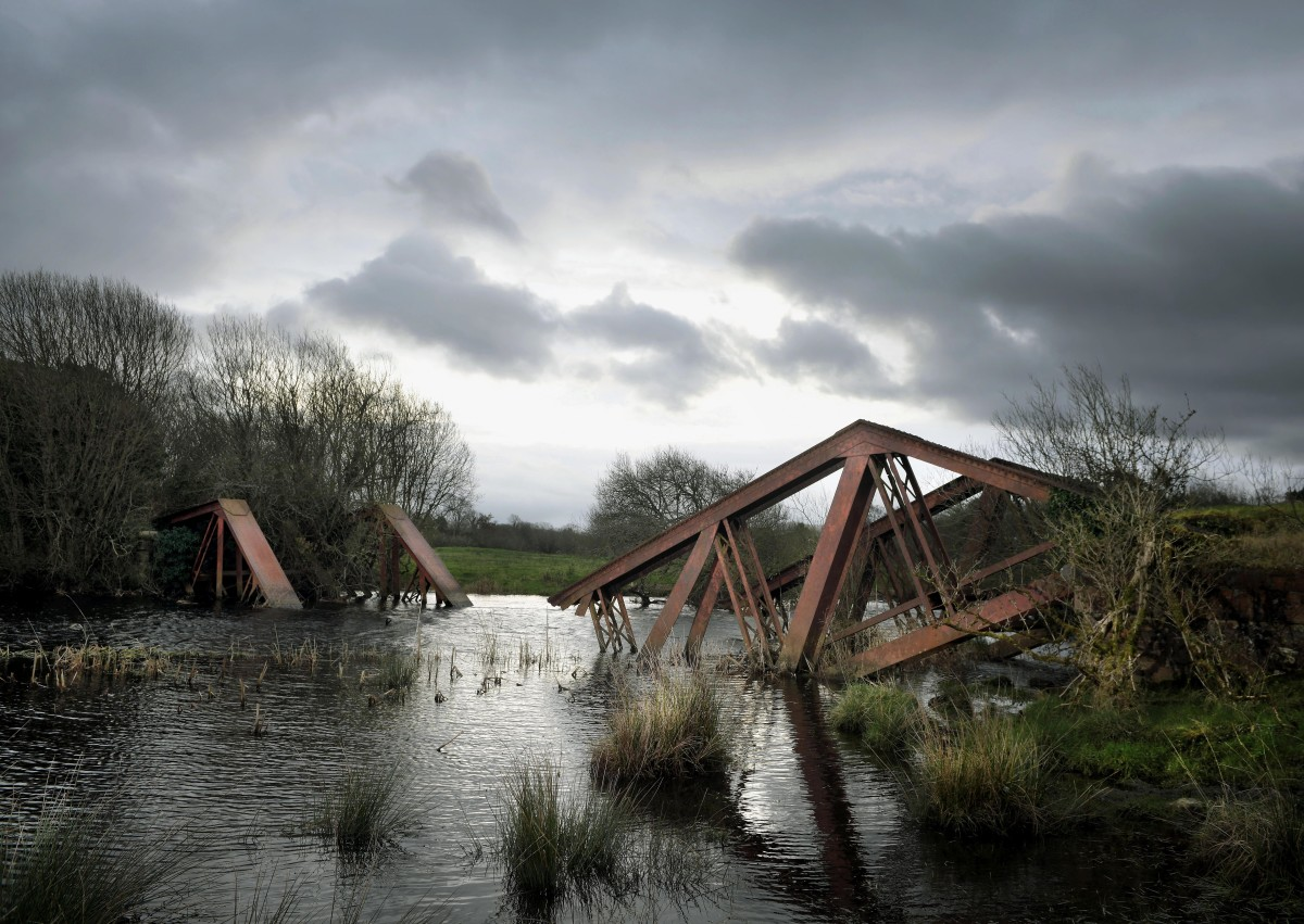 "The remains of a railway bridge between the villages of Blacklion in the Republic of Ireland and Belcoo in Northern Ireland can be seen on February 22nd, 2019, in Belcoo, Northern Ireland. The bridge was blown up by the British army in the 1970s during the Troubles. Along the winding 499 kilometers of the Irish border are vestiges of a harder boundary: derelict customs houses, ""dragon's teeth"" bollards and two-toned tarmac. These relics evoke a time when movement between the countries was less free, and underscore what is at stake as the U.K. negotiates its exit from the E.U. Both parties have vowed to avoid a physical border, but, as the Brexit deadline approaches on March 29th, a final agreement has so far eluded them."