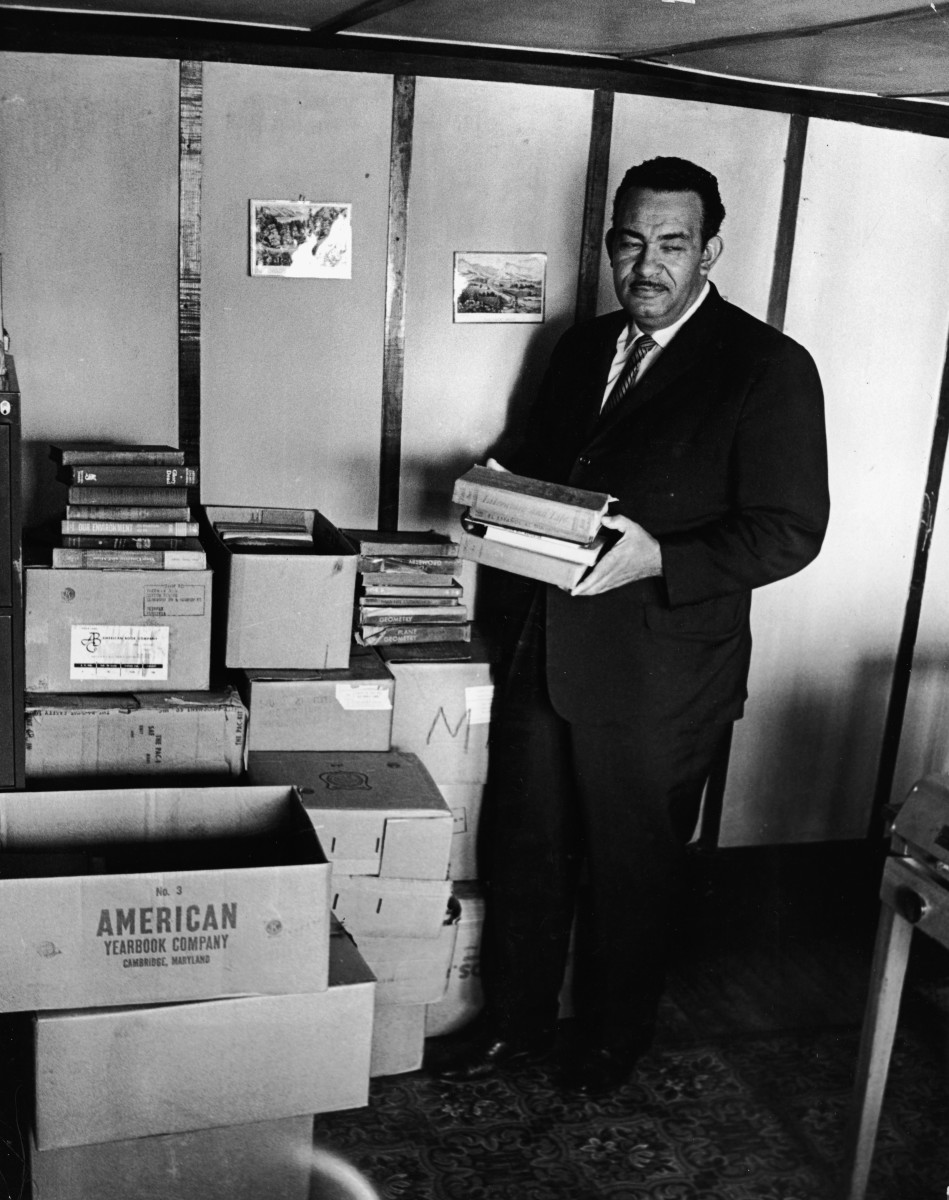 Civil rights activist Reverend Francis Griffin holds school books donated for the private schooling of black children, circa 1959. Prince Edward County, Virginia, shut down its public school system to avoid having to desegregate.