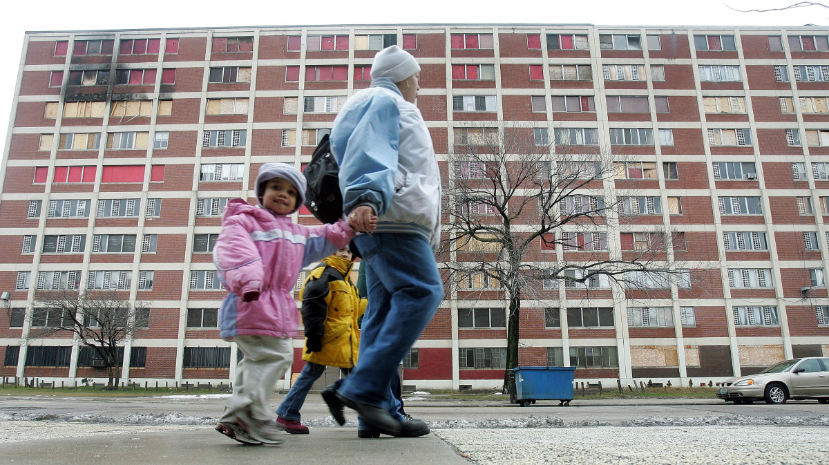 Residents walk past one of the few remaining Chicago Housing Authority Cabrini-Green public housing buildings January 12th, 2005, in Chicago, Illinois.
