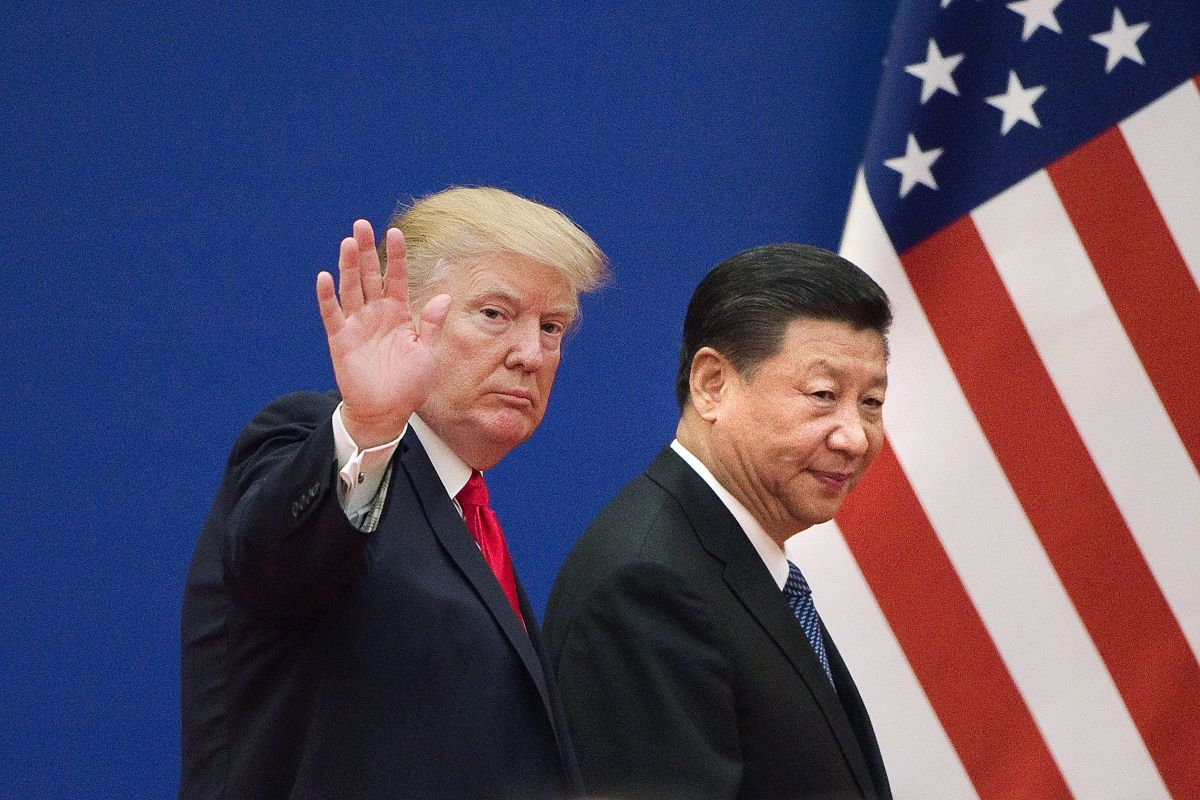 President Donald Trump and China's President Xi Jinping leave a business leaders event at the Great Hall of the People in Beijing.