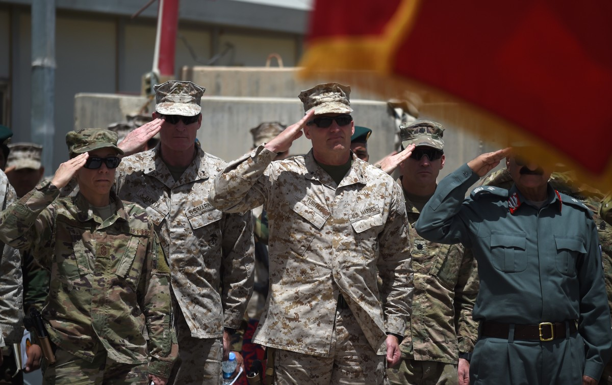 U.S. Marine Brigadier General Roger Turner and Afghan officials salute during a handover ceremony at Leatherneck Camp in Lashkar Gah in Helmand Province on April 29th, 2017.