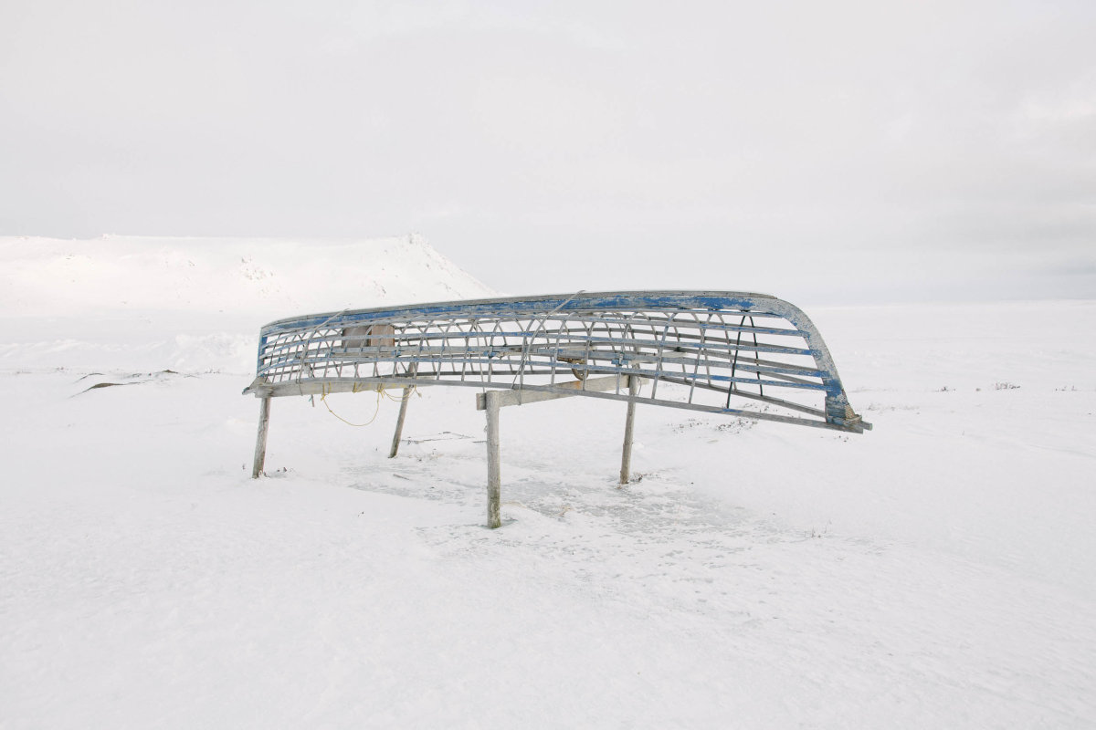 The frame of a traditional skinboat rests on trestles. The Yup'ik have hunted and fished Gambell's prolific seas for thousands of years, but some families have recently had to abandon the use of skinboats for hunting, as retreating sea ice is threatening the walrus herds and shortening the hunting season.