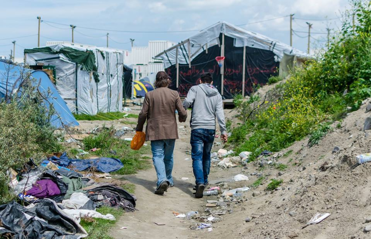 During one of James Pearce's 2016 visits to the Calais Jungle, a refugee member of PC4R recognized him from far away, greeted him warmly, and invited him to share a meal.