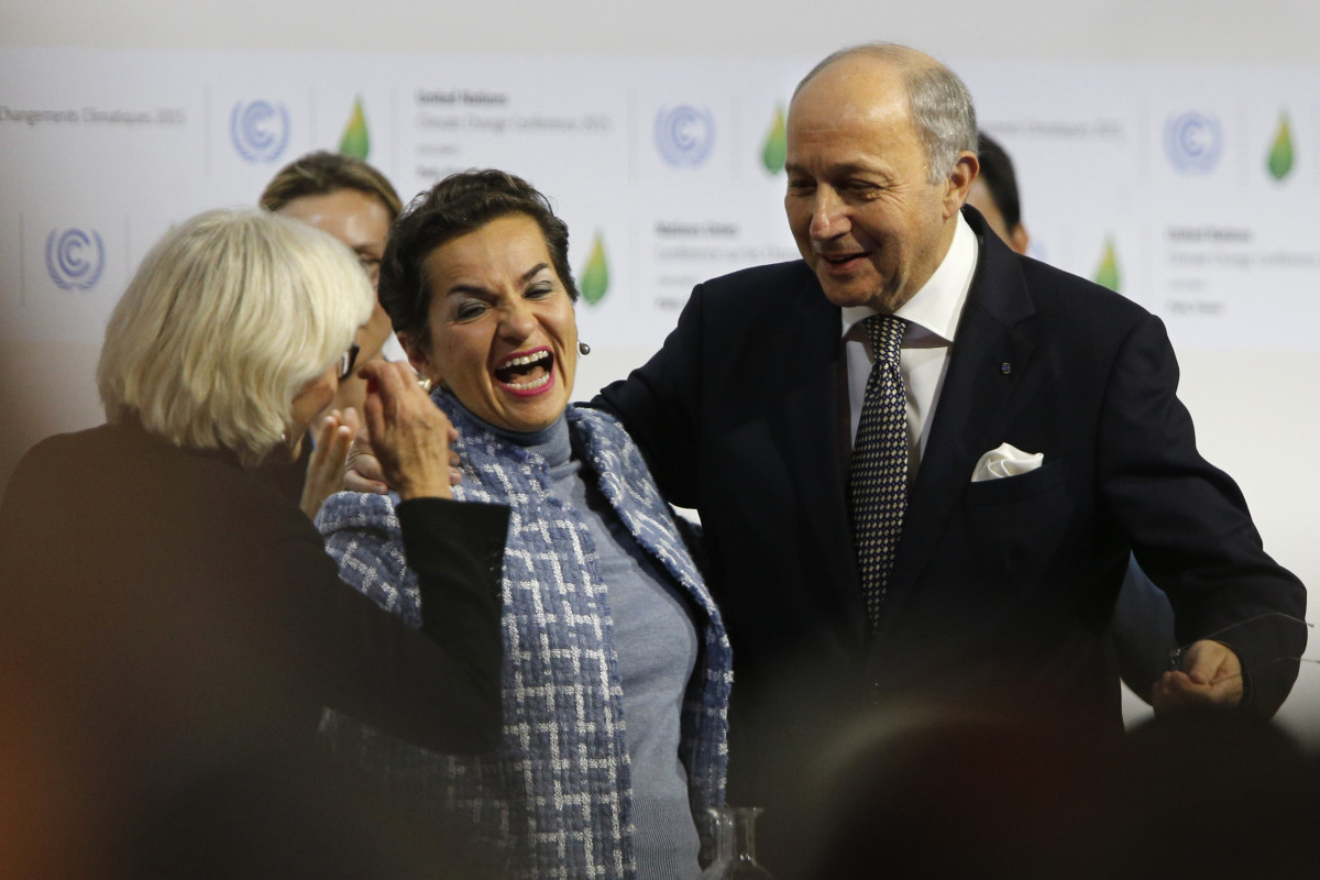 Then-Executive Secretary of the United Nations Framework Convention on Climate Change Christiana Figueres (center) celebrates with Laurence Tubiana, the French ambassador for climate (left), and Laurent Fabius, the French minister for foreign affairs (right), after adopting the historic Paris Agreement at the COP21 Climate Conference in Le Bourget, north of Paris, on December 12th, 2015.