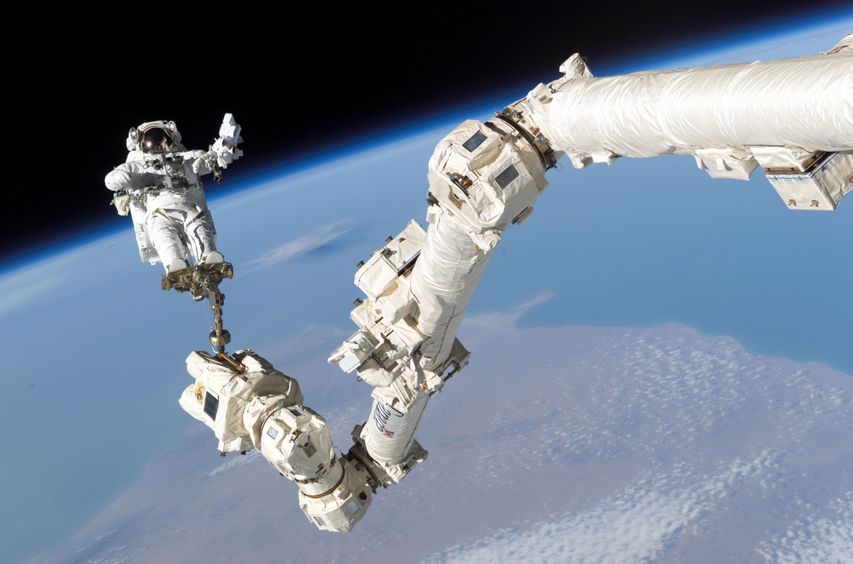 An astronaut conducts a spacewalk at the International Space Station in 2005.