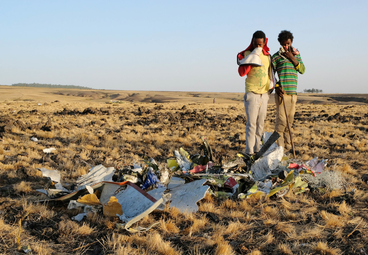 Two local boys examine a pile of twisted metal gathered by workers during the continuing recovery efforts at the crash site of Ethiopian Airlines Flight 302 on March 11th, 2019, in Bishoftu, Ethiopia. The plane was just six minutes into its flight to Nairobi, Kenya, when it crashed, killing all 157 passengers and crew on board on March 10th. As a result of the crash, Ethiopia joined China and other countries in grounding its fleet of Boeing 737 Max 8 jets.