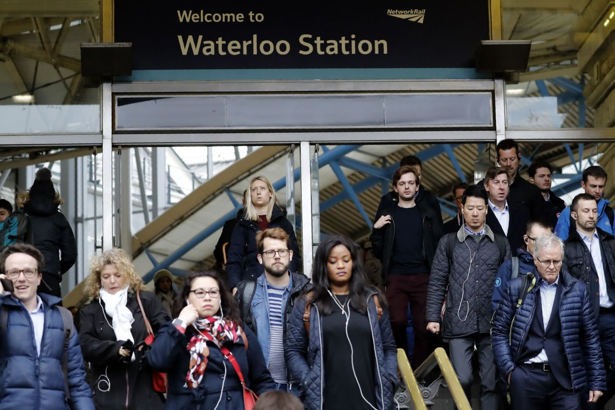 Commuters walk at Waterloo station in central London on March 6th, 2019, a day after a suspicious package was found at the station.