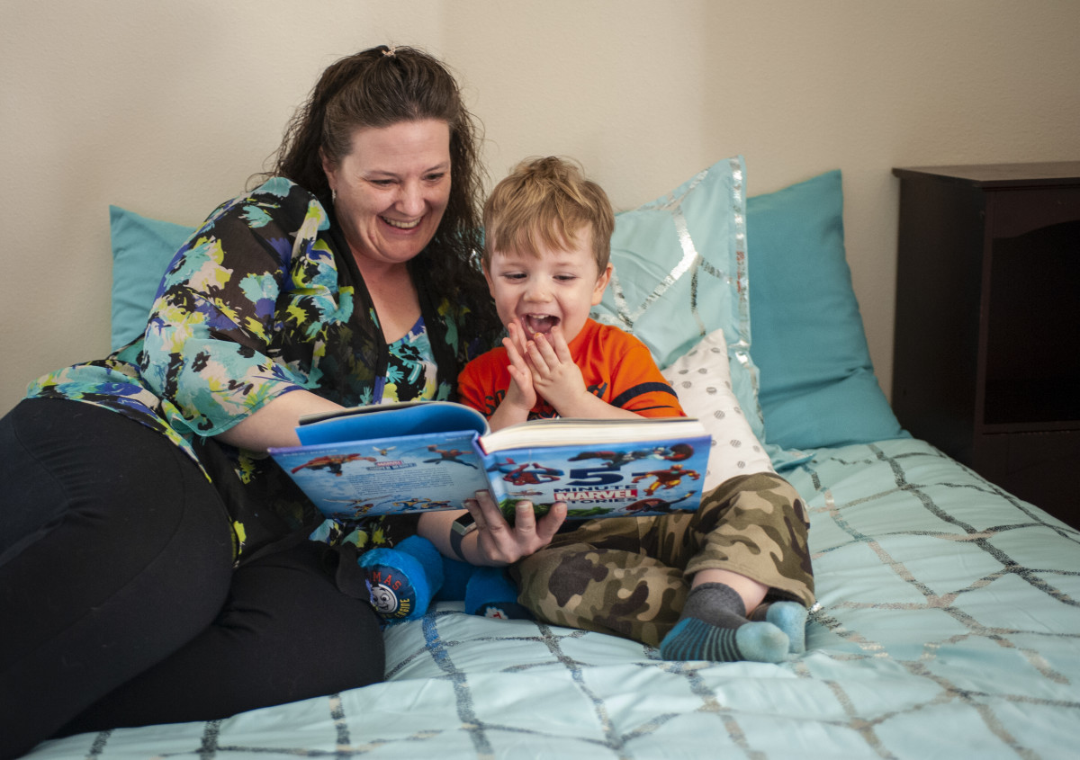 Dorothy Gorder and her son in an apartment she got with help from her community college.