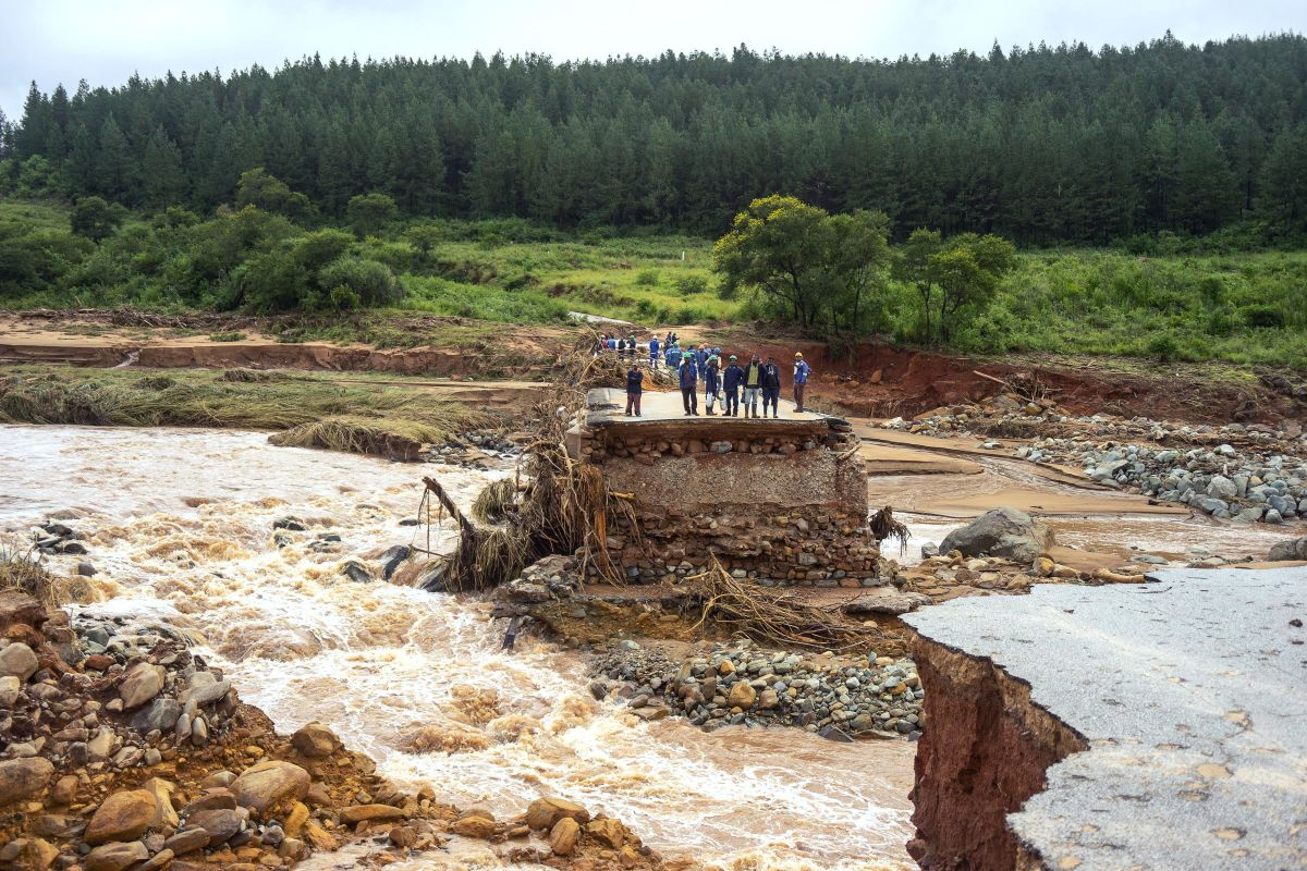 Timber company workers stand stranded on a damaged road on March 18th, 2019, at Charter Estate, in Chimanimani, eastern Zimbabwe, after Cyclone Idai ripped across Mozambique, Zimbabwe, and Malawi. The Red Cross has reported at least 215 deaths, and President Filipe Nyusi of Mozambique said he fears the death toll may reach over 1,000. Cyclone Idai tore into the center of Mozambique on the night of March 14th before barreling into neighboring Zimbabwe, bringing flash floods and ferocious winds, and washing away roads and houses.