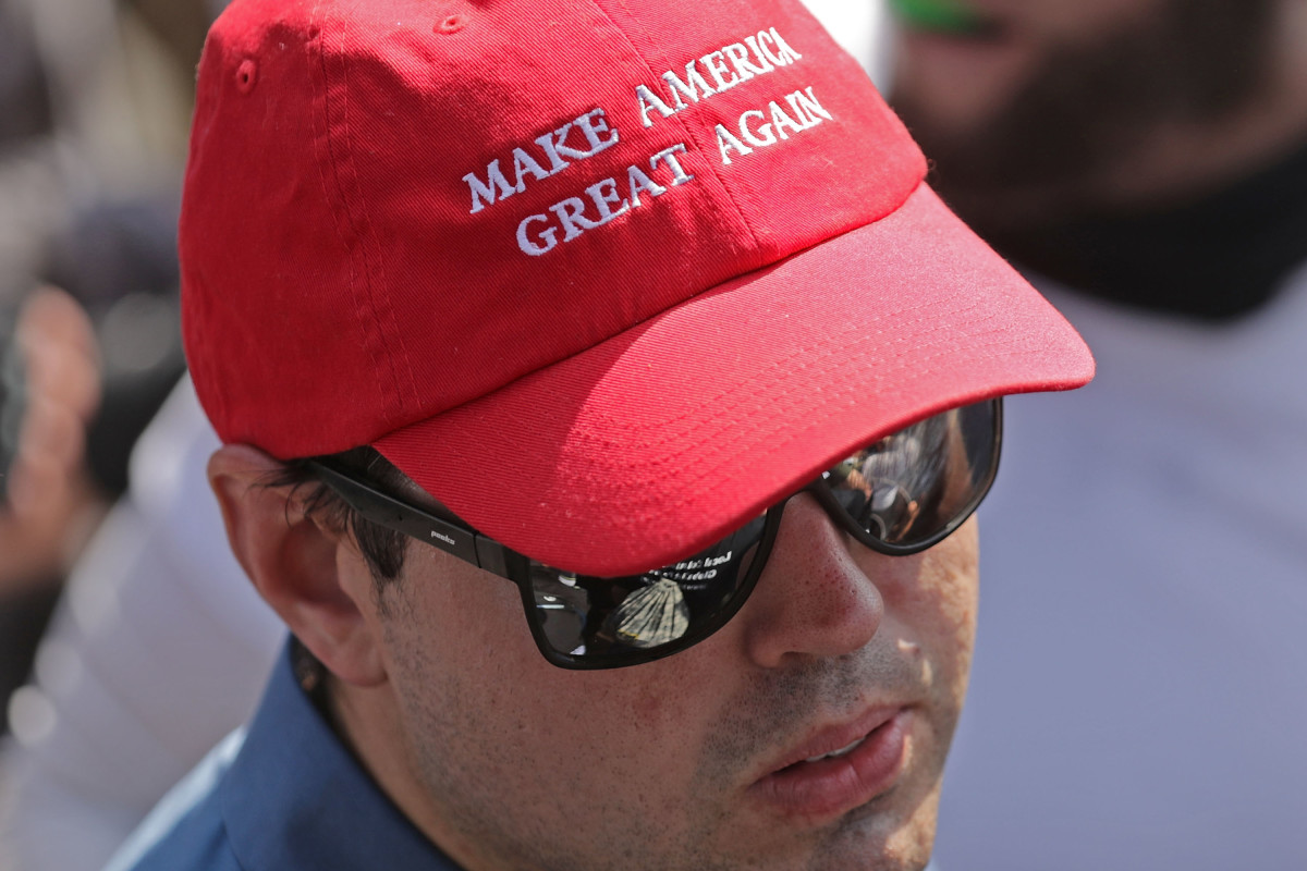 A man wears a Make America Great Again hat during the Unite the Right rally on August 12th, 2017, in Charlottesville, Virginia.