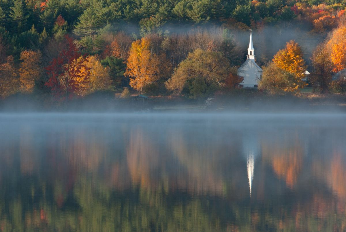 Church in nature on lake Christianity