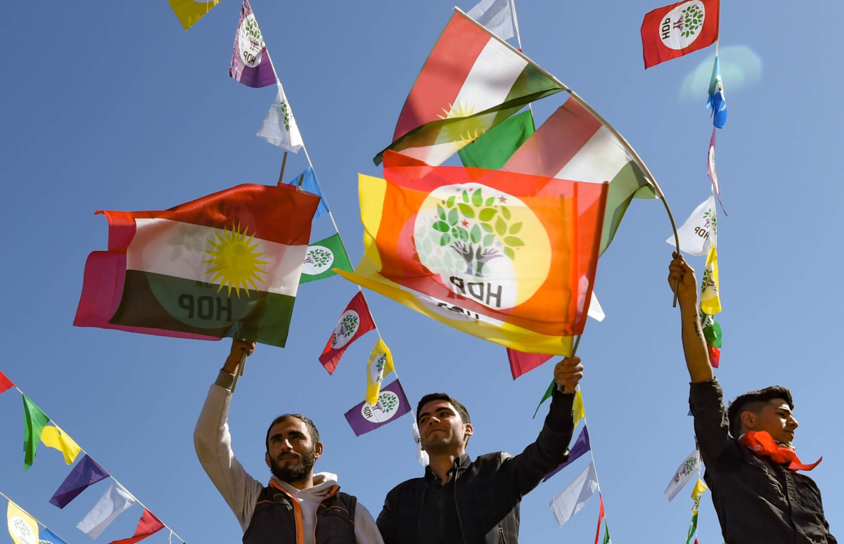 Men wave flags as they celebrate Nowruz festivities on March 21st, 2019, in Diyarbakir, Turkey. Nowruz, which starts on the vernal equinox and marks the Iranian New Year, is celebrated by more than 300 million people in diverse communities across the world.