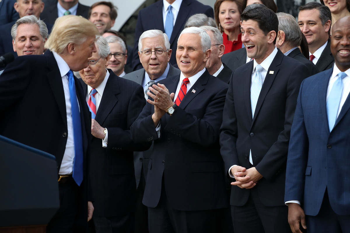 Donald Trump, Mike Pence, Mitch McConnell, and Paul Ryan celebrate the passage of the Tax Cuts and Jobs Act of 2017 on the South Lawn of the White House.