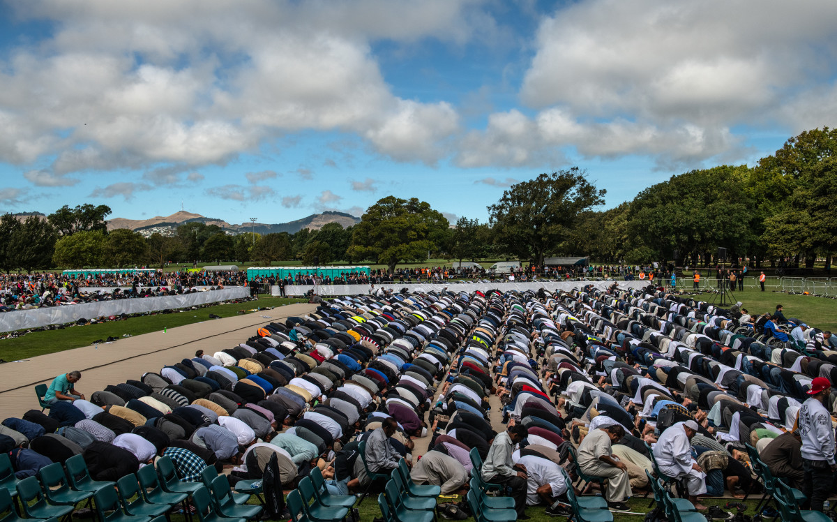 Muslims attend Friday prayers in a park near Al Noor mosque on March 22nd, 2019, in Christchurch, New Zealand. Fifty people were killed, and dozens were injured in Christchurch on Friday, March 15th, when a gunman opened fire at the Al Noor and Linwood mosques.