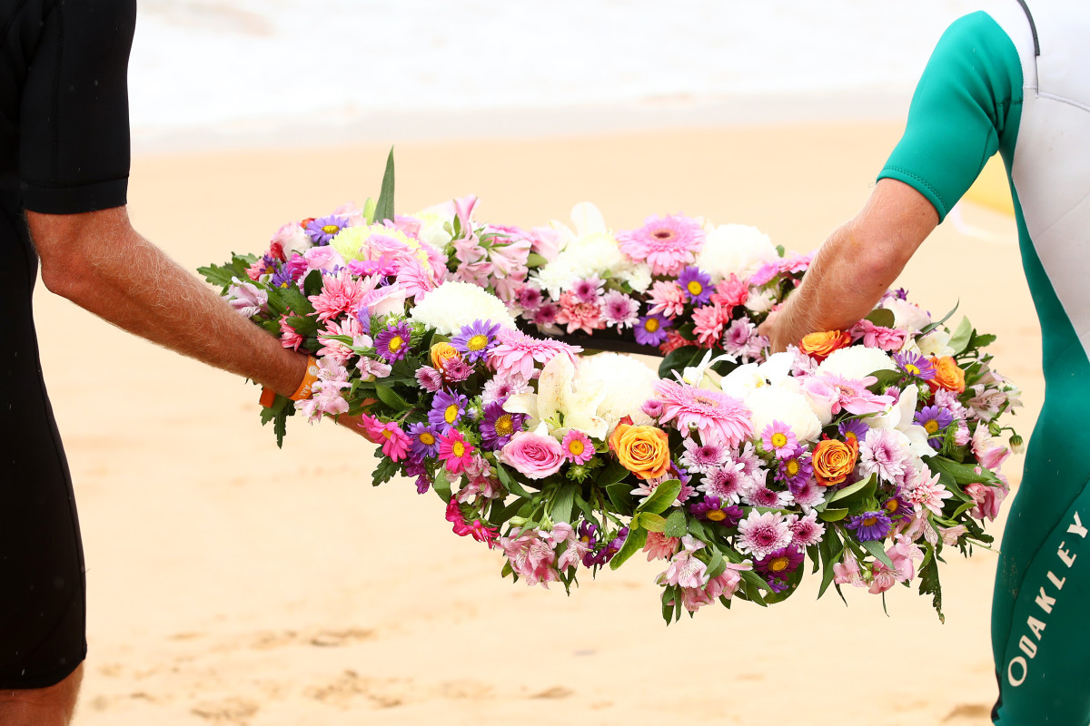 Locals and surfers competing in the Sydney Surf Pro participate in a paddle-out and wreath laying and observe a minute of silence to remember victims of the Christchurch mosque attacks at Manly Beach on March 17th, 2019, in Sydney, Australia.