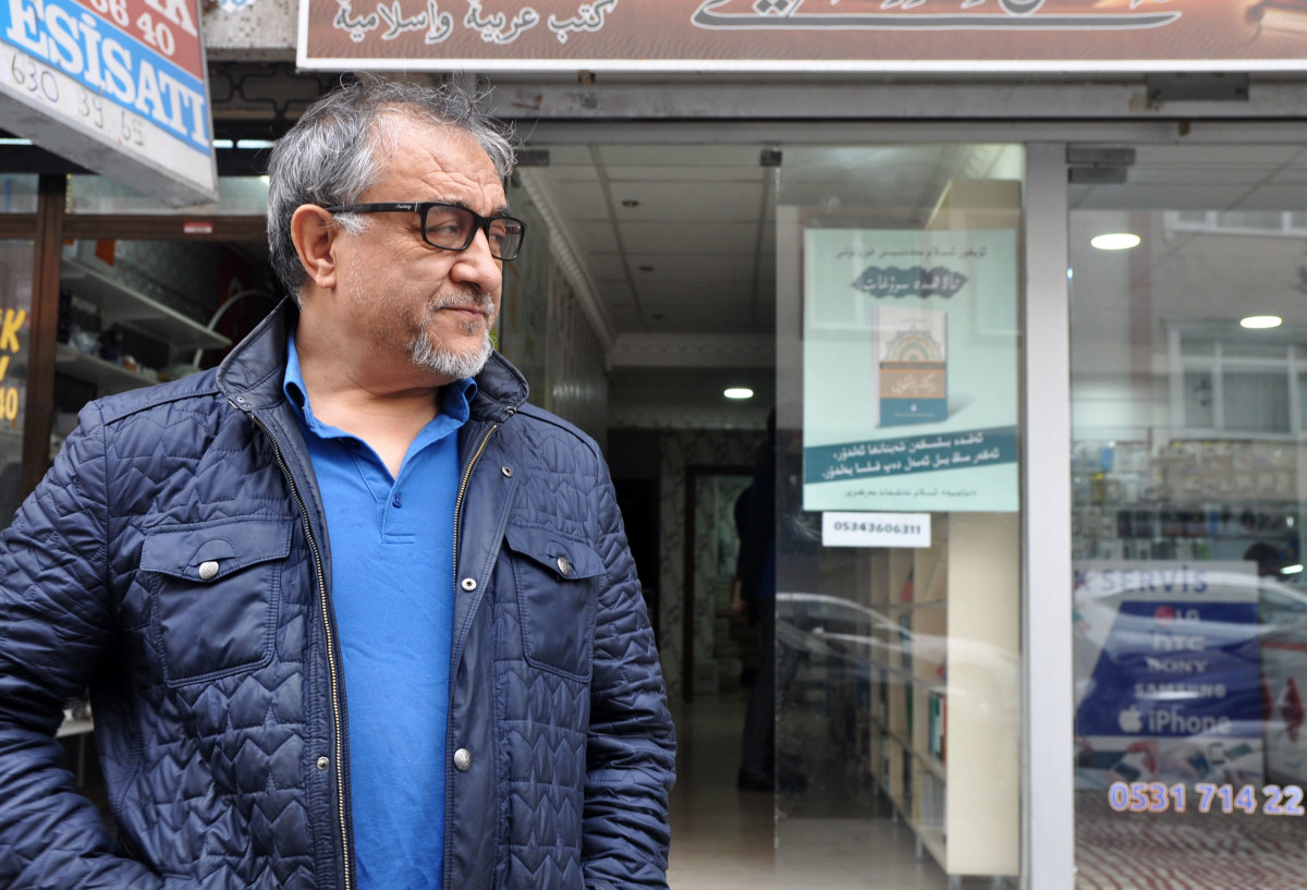 Abduljelil Turan, 60, stands outside his Uyghur-language publishing house and bookstore in Istanbul.