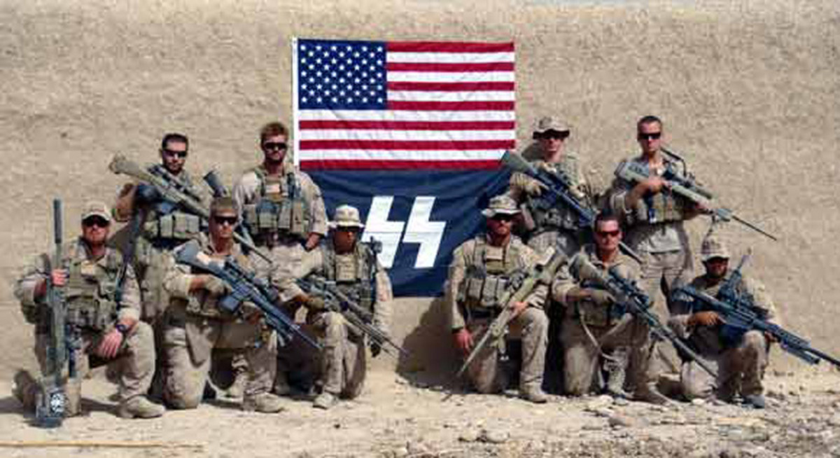 U.S. Marines pose with a SS Flag in 2012.