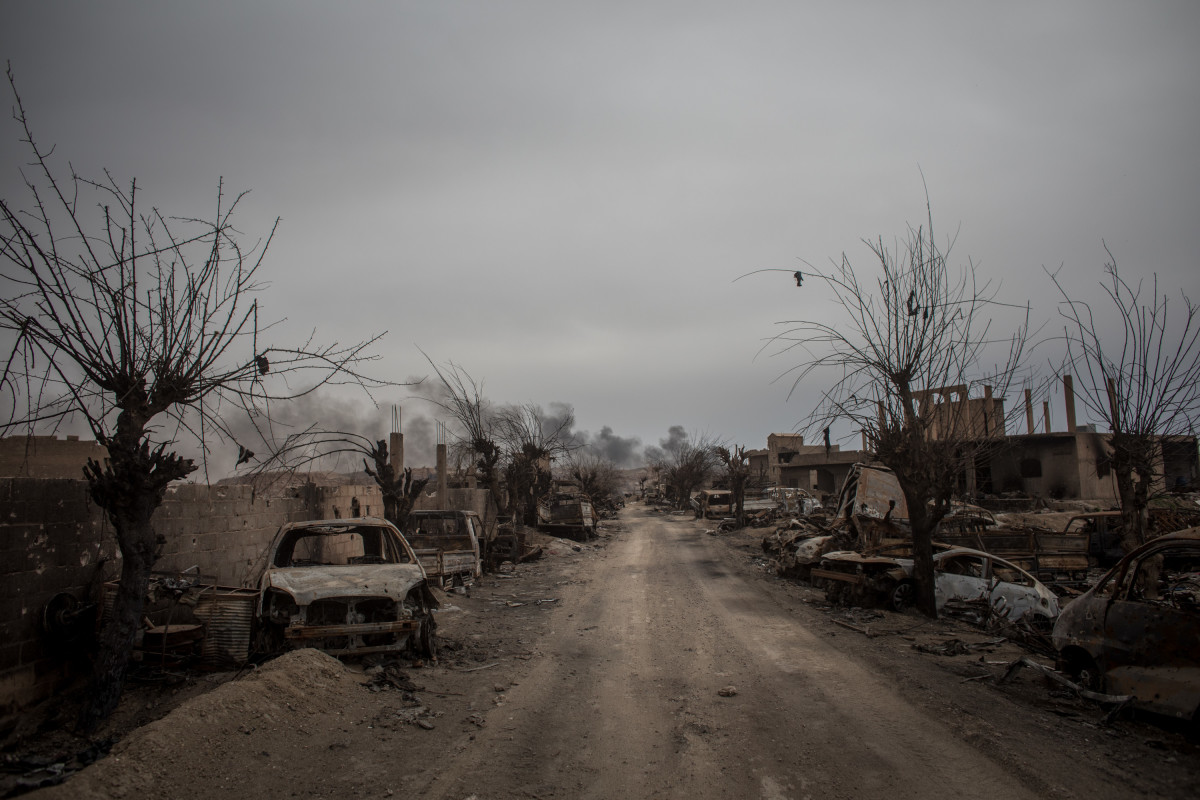 Destroyed vehicles are seen in the final ISIS encampment on March 24th, 2019, in Baghouz, Syria.
