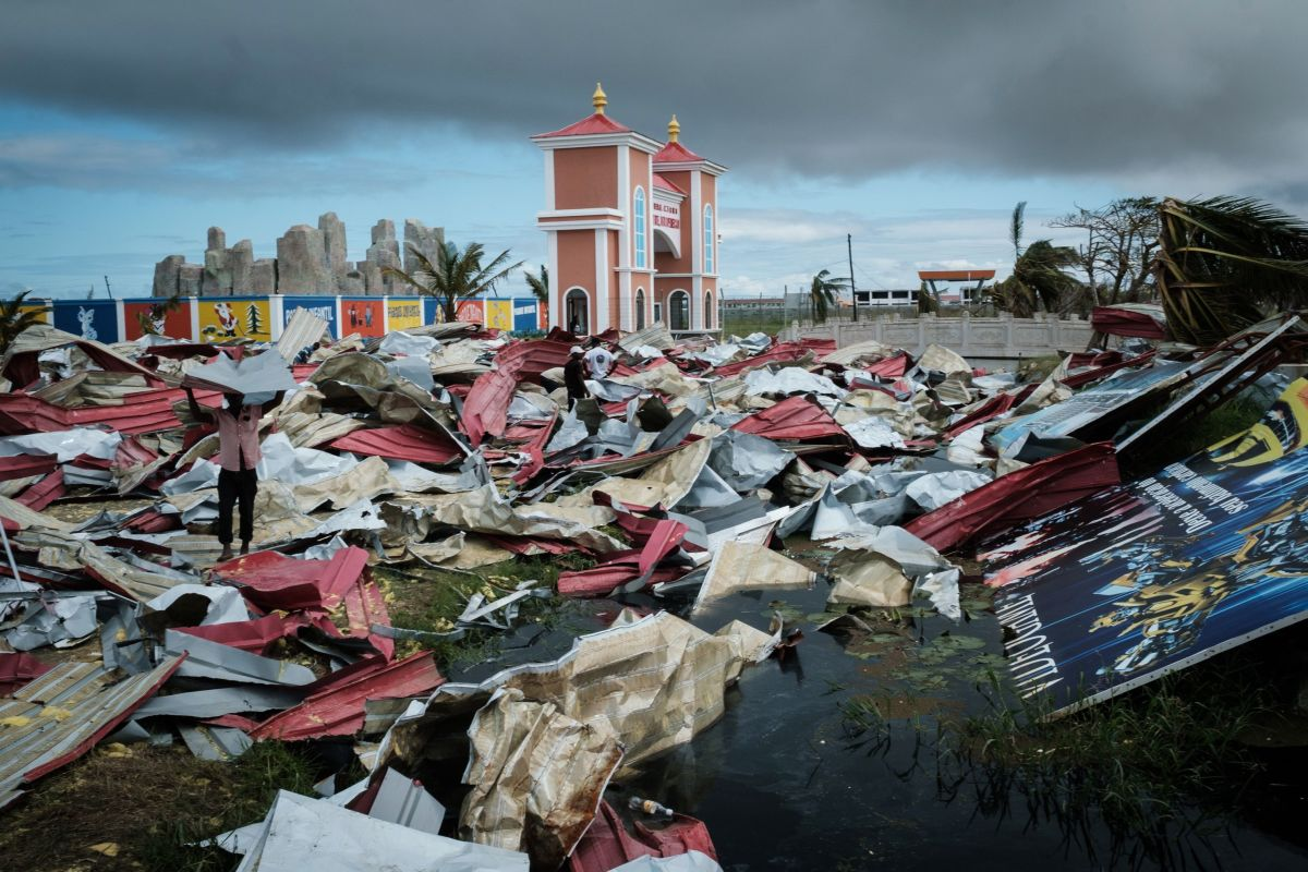 People collect metal sheets from a damaged supermarket to re-build their destroyed houses following the devastation caused by Cyclone Idai in Beira, Mozambique, on March 21st, 2019.