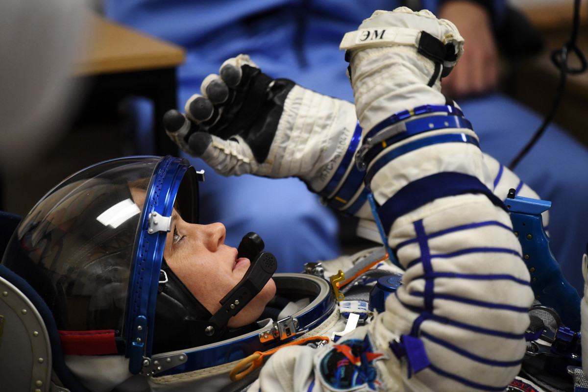 NASA astronaut Anne McClain reacts as her space suit is tested prior to the launch onboard the Soyuz MS-11 spacecraft at the Russian-leased Baikonur cosmodrome in Kazakhstan on December 3rd, 2018.
