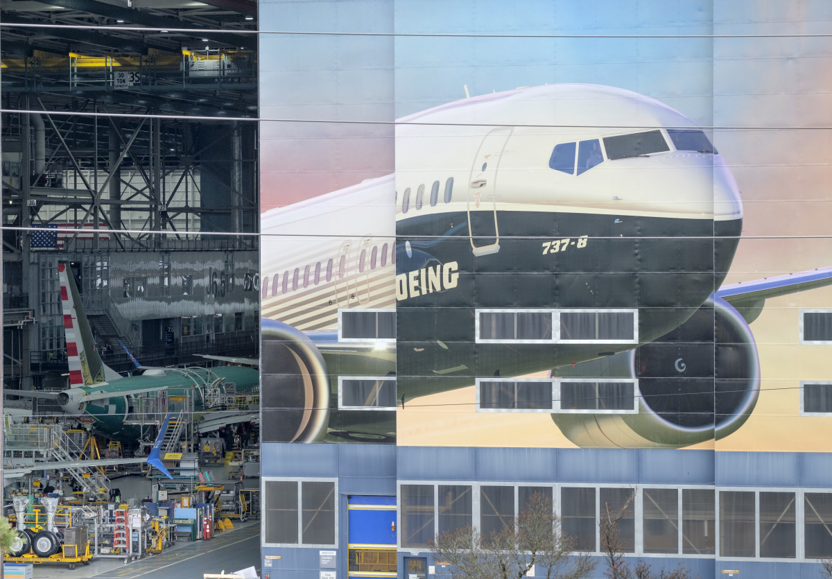 The Boeing 737 Max 8 is pictured on a mural on the side of the Boeing Renton Factory on March 11th, 2019, in Renton, Washington.