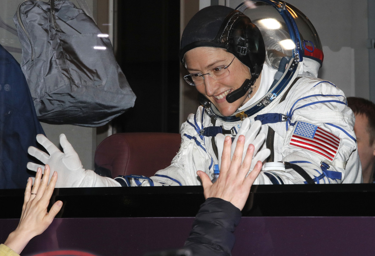 NASA astronaut Christina Koch gestures from inside a bus shortly before her expedition launched at the Russian-leased Baikonur cosmodrome in Kazakhstan on March 14th, 2019.