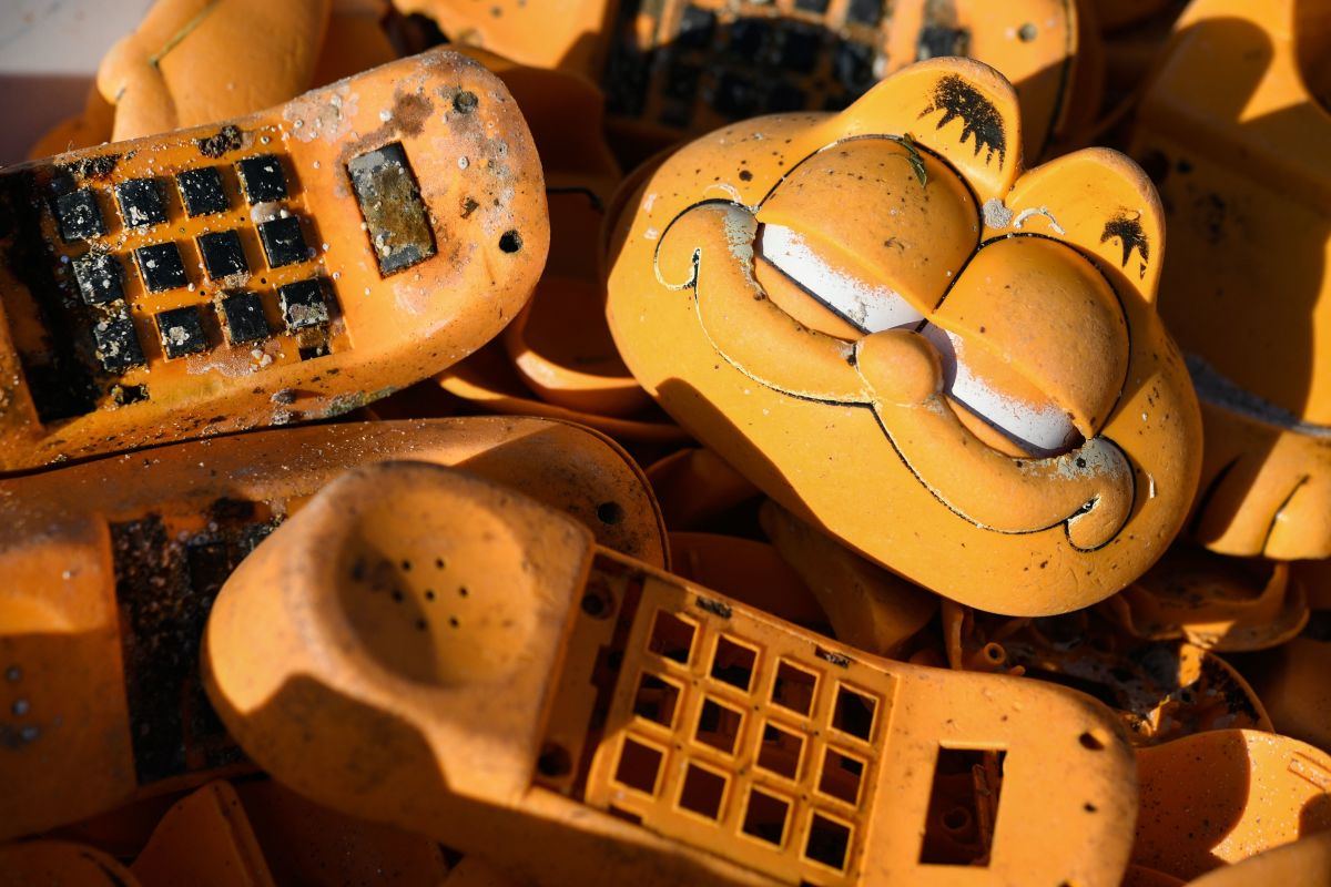 Spare parts of plastic Garfield phones littering a beach in western France.