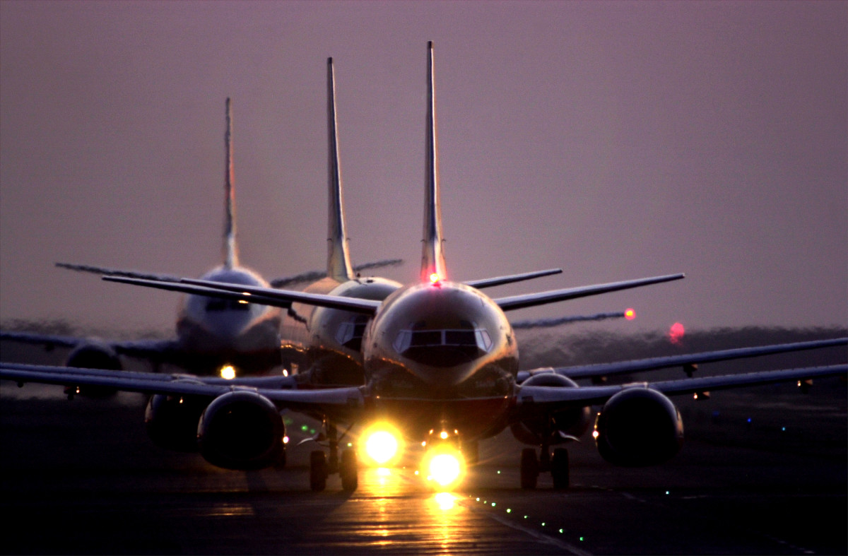 Jets taxi after sunset June 21st, 2001, at Los Angeles International Airport.